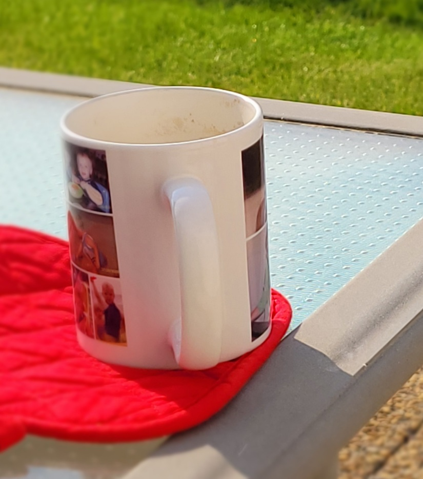 Mug of coffee on a patio table.