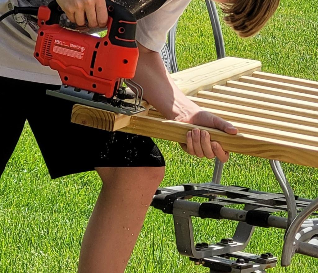 A jig saw cutting a railing section.