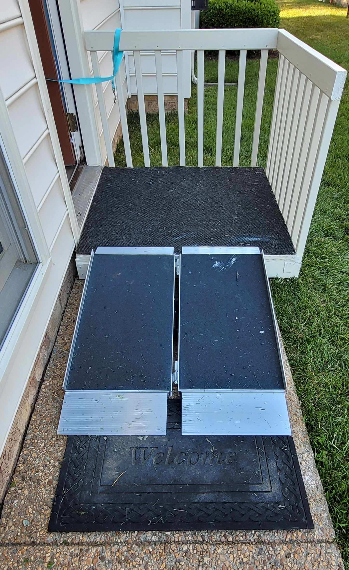 Completed, painted home built platform with suitcase ramp and aid to close door.