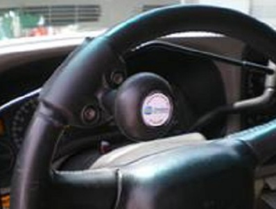 Spinner ball steering AT device. Pic edited from RehabMart website.