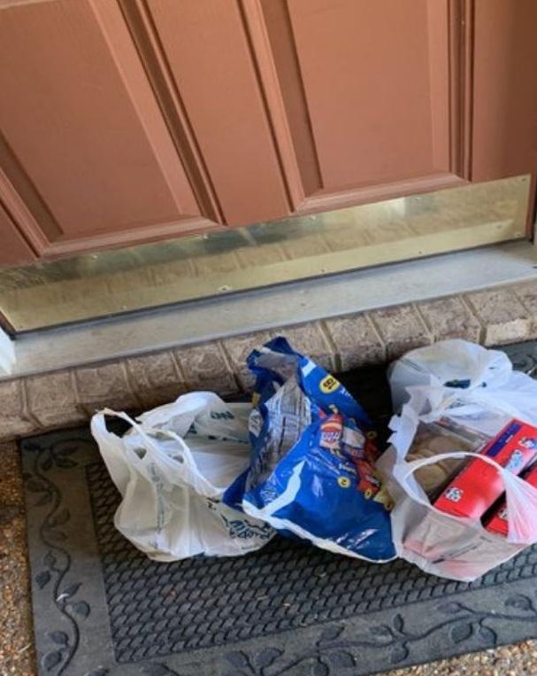 Groceries in front of door.